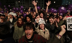 Podemos supporters celebrate the election results in December