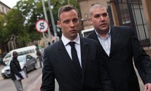 Oscar Pistorius, left, outside the Gauteng North high court during a break in proceedings.
