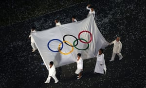 The Olympic flag is carried by Daniel Barenboim, Sally Becker, Shami Chakrabati CBE, Leymah Gbowee, Haile Gebrselassie, Doreen Lawrence OBE, Ban Ki-moon and Marina Silva during the Opening Ceremony of London 2012.
