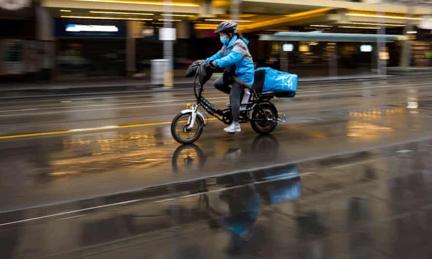 A food delivery rider in the rain in Melbourne