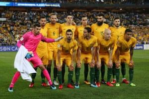 Goalkeeper Matthew Ryan belatedly joins the team photo.