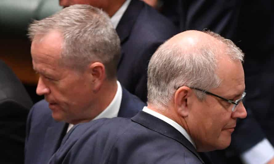 Bill Shorten and Scott Morrison cross paths during division in the House of Representatives