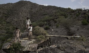 Fighters from a militia known as the Security Belt, that is funded and armed by the United Arab Emirates, stand on a tank camouflaged with brush, at the Gabhet Hajr frontline with Houthi rebels in Yemen