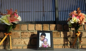 A framed photo of Óscar Alberto Martínez Ramírez and his daughter, Angie Valeria, sits on an altar with flowers during a candlelight vigil in Brownsville, Texas, on 30 June.