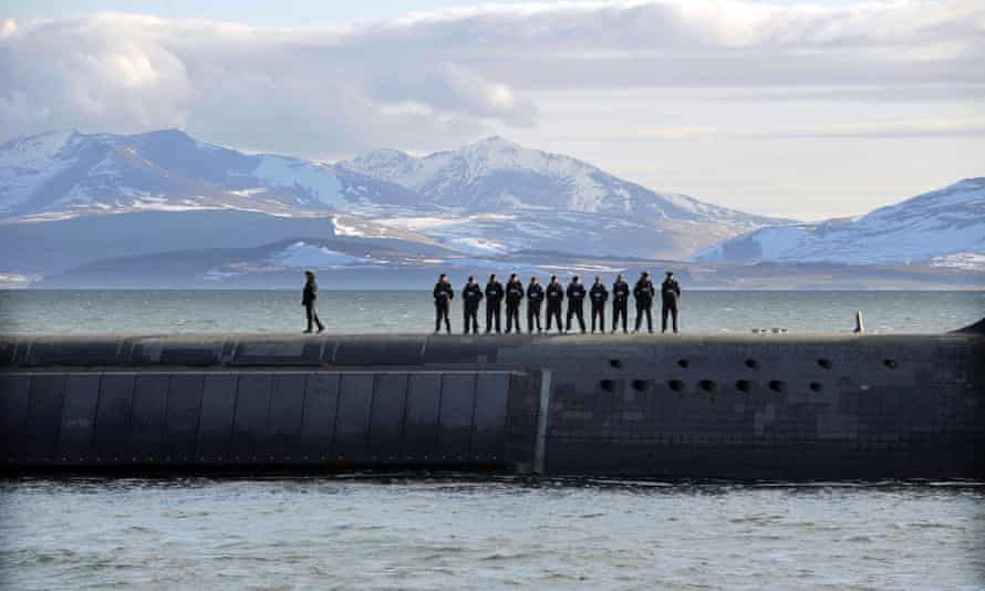British Navy personnel stand atop the Trident Nuclear Submarine, HMS Victorious, on patrol off the west coast of Scotland.