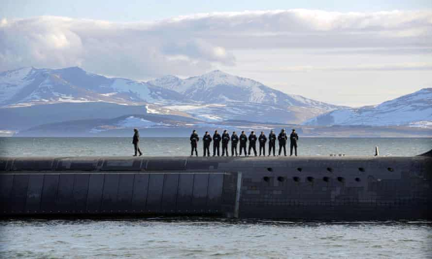 Navy personnel stand on HMS Victorious during a patrol off the west coast of Scotland.