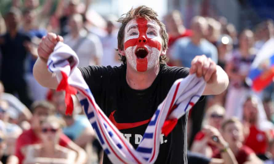 An England fan in Nizhny Novgorod watches the 2018 World Cup group game against Panama in the fan zone
