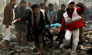 Yemeni rescue workers carry a victim on a stretcher after reported airstrikes by the Saudi-led coalition on a funeral hall in Sana'a on 8 October 2016