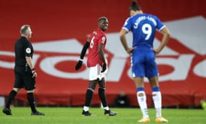 Paul Pogba walks off injured.