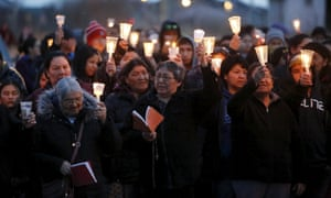 People take part in a march and candlelight vigil in the Attawapiskat First Nation in northern Ontario, Canada.
