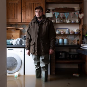 Joseph Howsam in his flooded home in Fishlake Village