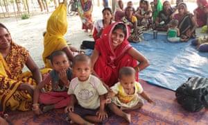 Gita Gupta (in yellow sari) with Seema Agrahari and her three children
