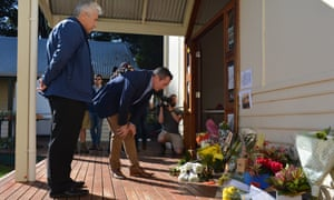 Western Australia premier Mark McGowan (centre) at Margaret River community centre, where locals laid flowers in tribute to the seven members of the Miles family who died in a murder-suicide shooting.