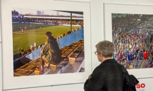 A visitor looks at a photograph in the Stuart Roy Clarke exhibition at the museum: Huddersfield Town at Southend United, Roots Hall, 1991.