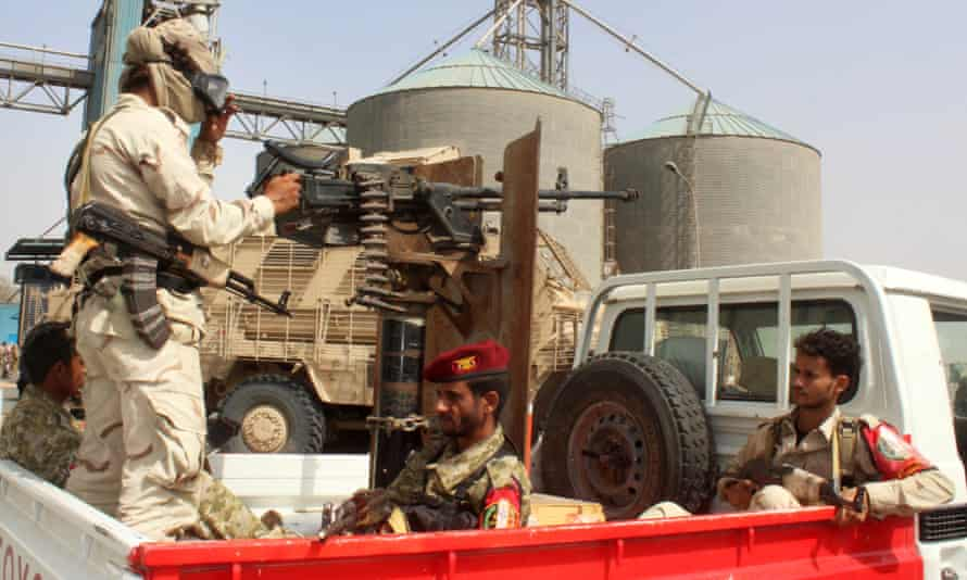 Soldiers with a military coalition in Yemen backed by Saudi Arabia and the UAE stand guard at a grain facility in Hodeida on 22 January 2019.