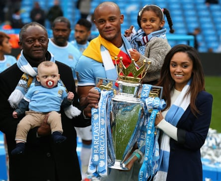 Vincent Kompany of Manchester City poses with the Premier League trophy and his family at the end of the Barclays Premier League match between Manchester City and West Ham United at the Etihad Stadium on May 11, 2014 in Manchester, England.