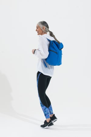 white long sleeved jacket, blue and black leggings Gap, blue and black backpack Sweaty Betty, black and white trainers