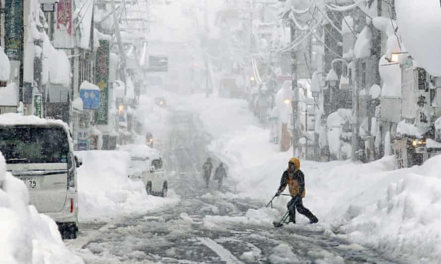Japanese Cities Blanketed In Record Levels Of Snowfall Japan The Guardian