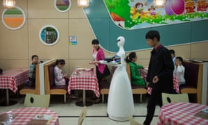 Can be frustratingly slow … a robot waiter makes her rounds in Kunshan in 2016.