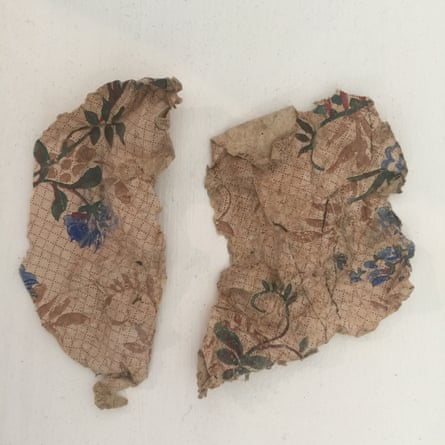 Fragments of squared paper with watercolour flowers