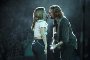 Bradley Cooper and Lady Gaga sing on stage in A Star Is Born