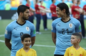 Uruguay's Luis Suarez and Edinson Cavani exchance glance as the teams line up for the national anthems before beating Saudi Arabia 1-0 at the Rostov Arena.