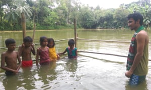 Instructor Shohag Hossain teaches students in a specially constructed swimming area.