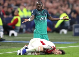 Tottenham Hotspur's Moussa Sissoko gets himself a yellow card after a foul on Ajax's Nicolas Tagliafico