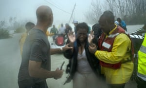 Volunteers rescue people from rising flood waters in Freeport, Grand Bahama