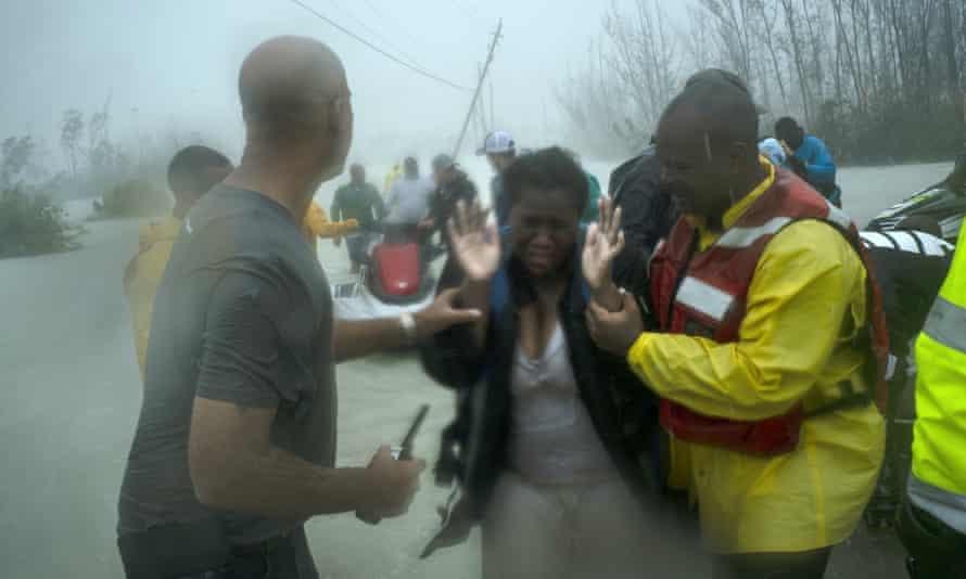 Volunteers rescue people from rising flood waters in Freeport, Grand Bahama