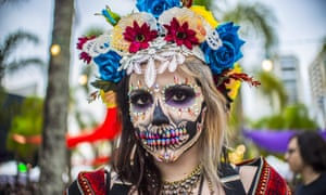 A woman dressed as La Catrina.