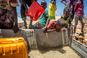 Children drink water delivered by a truck in the drought-stricken Baligubadle village near Hargeisa, the capital city of Somaliland, in this handout picture provided by The International Federation of Red Cross and Red Crescent Societies on March 15, 2017.