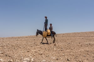 Awdeh's nephews on their daily trip to deliver water to different parts of the Bedouin village