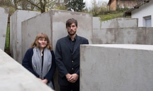 Members of the art collective Centre for Political Beauty pose inside the replica of Berlin's Holocaust memorial.
