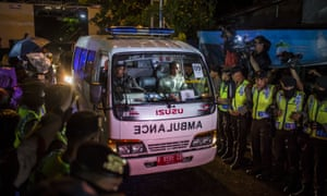 An ambulance carrying the body of one of the four men executed by firing squad at Nusa Kambangan arrives in Cilacap, Indonesia.