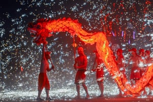 Chinese folk artists perform a fire dragon dance during a temple fair in Tianjin, China