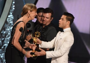 Actor Rami Malek accepts the Emmy for Outstanding Lead Actor in a Drama Series from actress Allison Janney