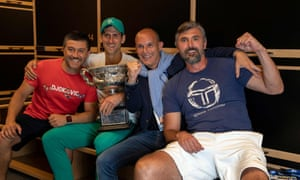 Novak Djokovic and his backroom team, including Goran Ivanisevic (right), celebrate after the match.