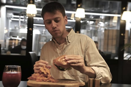 Oliver Holmes tries the burger at the Chicken.