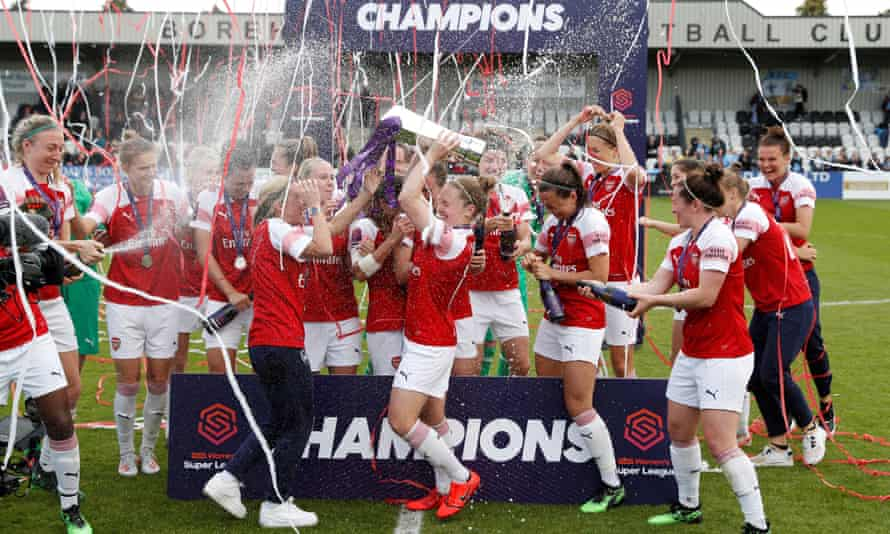 Arsenal celebrate with the trophy after winning the first Women's Super League title of the fully professional era.
