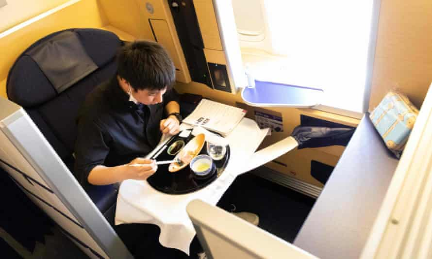 A diner tucks into his £391 onboard meal. Views of the tarmac come gratis.