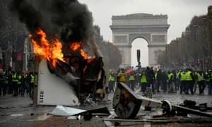 A truck burns on the Champs-Élysées in Paris