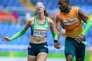 Rio de Janeiro, BrazilBrazil's Lorena Salvatini Spoladore and her guide Renato Ben Hur Oliveira compete in a heat of the Women's 110 m (T11)