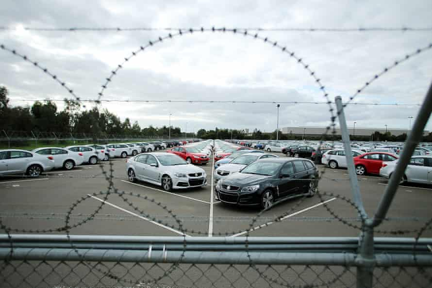 New cars are parked on the lot at the Holden manufacturing plant at Elizabeth