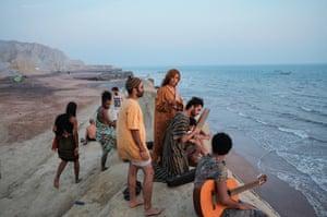 Iranian hippies observe the sunset. Niloofar (centre) is a primary school teacher in Shiraz. Hormoz island. Iran