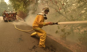 Eagle Field Fire Department firefighter Mark Jones extinguishes hot spots during the Glass Fire in St. Helena, California.