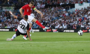 Jordan Henderson, England's captain for the night, gets a shot in