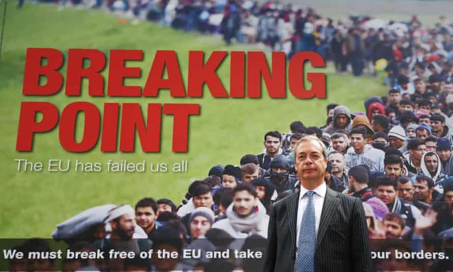 Ukip leader Nigel Farage poses in front of a poster depicting refugees during the EU referendum.