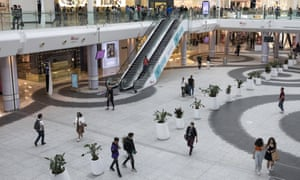 Shoppers in Westfield shopping centre in London as many non-essential stores reopened in England.
