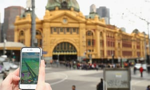 A Pokémon Go player in front of Flinders Street in Melbourne, Australia.